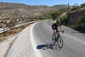 Frank is riding up the hilly segment towards Sounio!