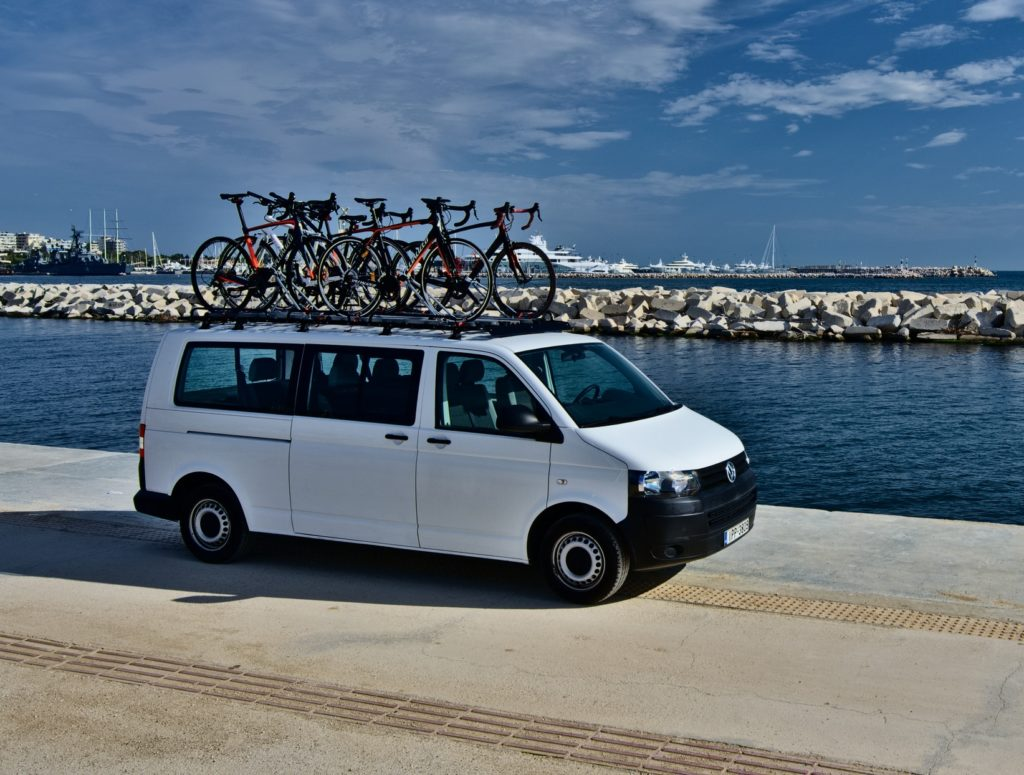 A van carrying rental bikes ready to deliver them everywhere.