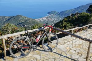 Panoramic view of Leonidio and a road race bike