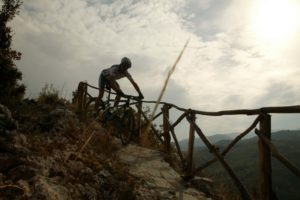 Epic shot of the mountain biker descending the a hard trail in the Peloponnese
