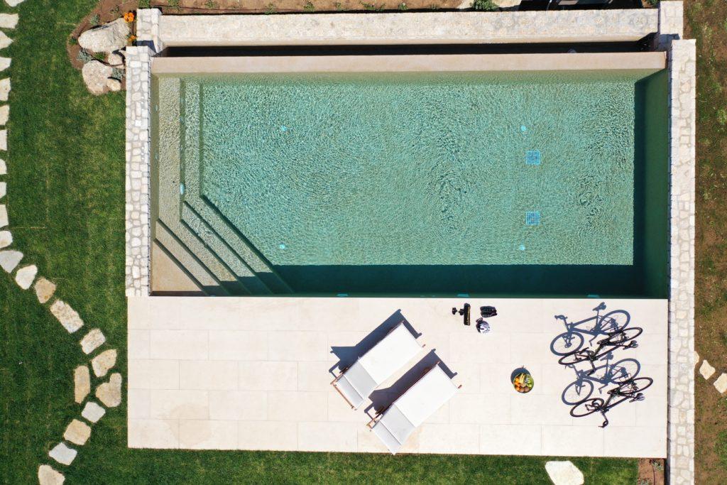 Pool view and road bikes at Magnificent Blue Villas Porto Heli