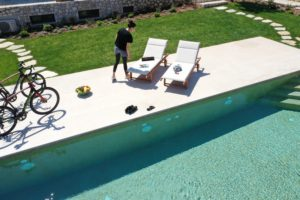 Cyclists by the pool Magnificent Blue Villas Porto Heli