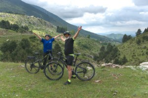 Father and son using ebikes enjoy exploring the region of mt. Olympus