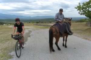 Wise shepard and a cyclist on a gravel bike in Olympus region