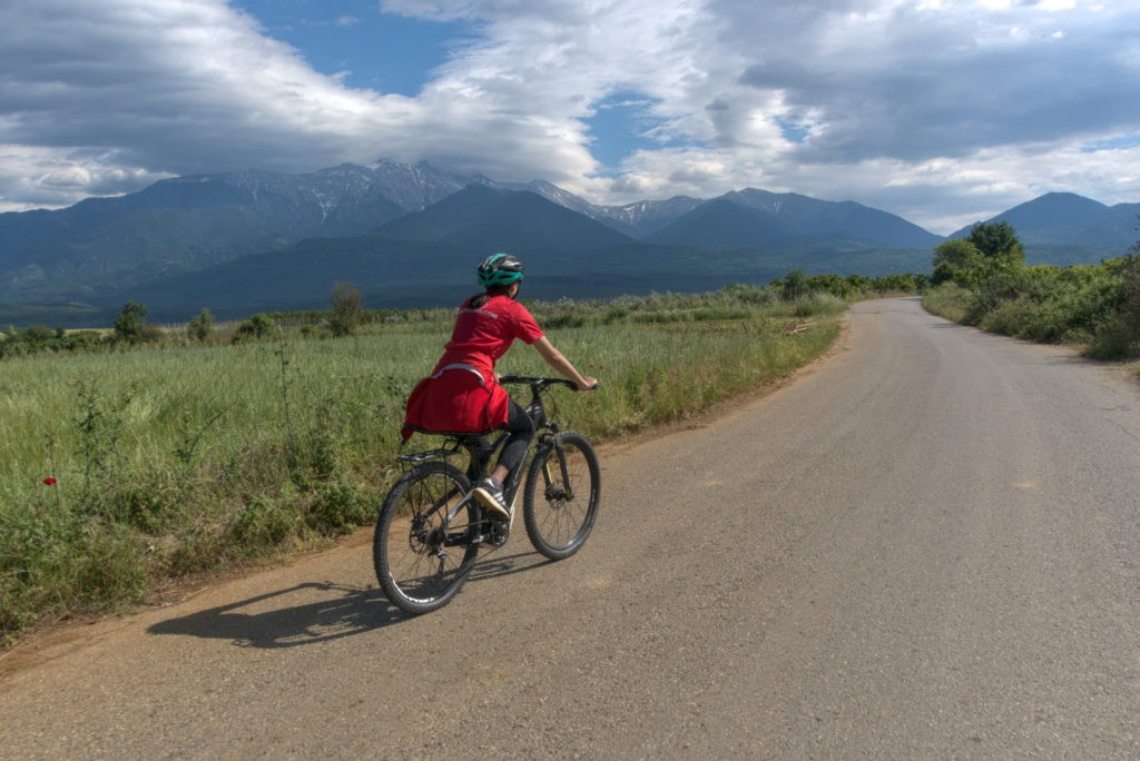Female cyclist with mt. Olympus in the background
