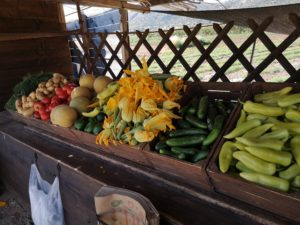 A farmers bench with vegetables and fruits