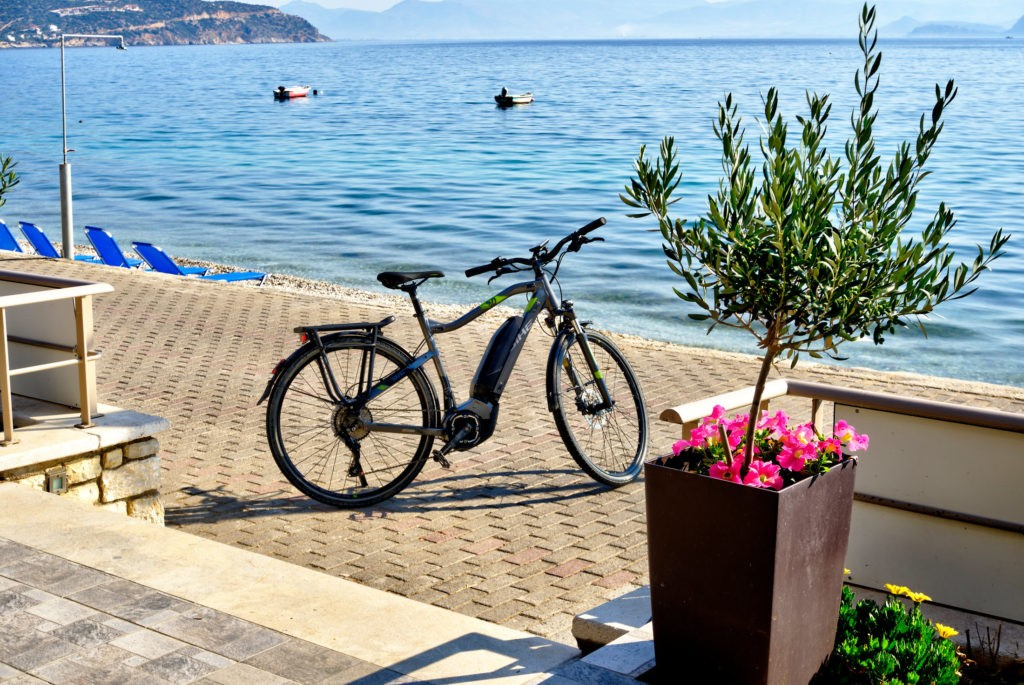 View of a bicycle in front of the sea, the view from Sunset Hotel