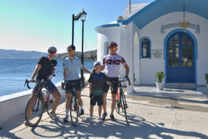 Family of cyclists posing just before the begin their cycling trip in Greece