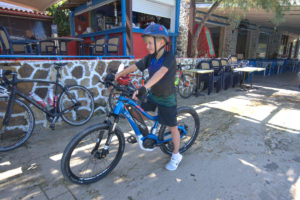 Child is cycling with an ebike part of the family trip