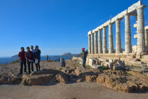 Family of cyclists are visiting archaeological sites in Greece