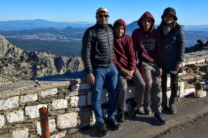 Family cyclists rest day and hiking at the top on Athens