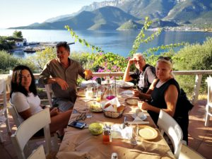 Two mature cycling couples enjoy their breakfast during their cycling trip