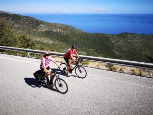 Lovely mature cycling couple enjoys the panoramic sea views from their cycling trips in thhe Peloponnese