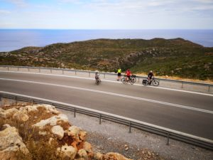 Mature cyclists are having a break at a hill's top in the Peloponnese