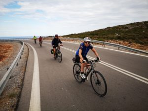 Cyclist are biking along the perfect coastal road in the Peloponnese