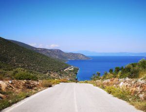 Road cyclist with the blue sea at the background in Pelion