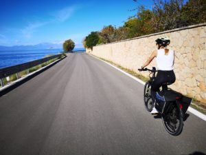 One of the daughter cycling during a family cycling trip in Aegina