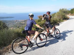 Female cyclists during their bike ride in Pelion, taking photos