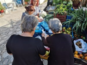 Women but groceries from the portable grocery store in Pelion, as captured by the cyclists