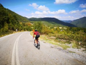 Cyclist heading uphill in the region of Olympus
