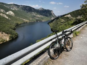 Impresive view of a road bike on Velvendos river during our rides around mountain Olympus