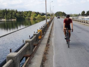 Velvedos dam with a cyclist crossing it