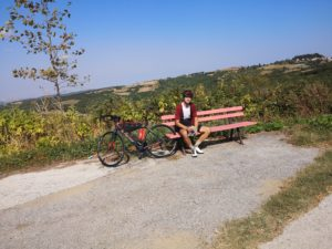 Road cyclist is having a break in one Olympus villages