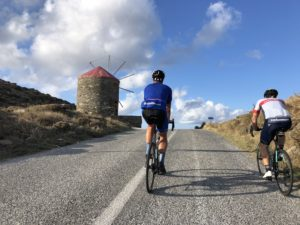 Cycling are cycling on the iconic part of Tinos island during a cycling trip