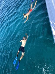 Cyclists enjoy their snorkeling time during their sailing vacations trip