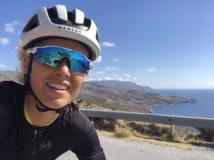 Female cyclist is cycling on Tinos Island