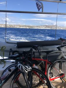Sailing on a catamaran and the view of road bikes with the open blue sea
