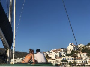 Cyclists who are chilling on the catamaran at the port of Syros