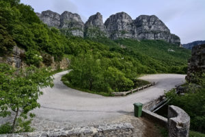 Winding road in Epirus with mountain top in the backround part of the cycling route