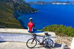 Cyclist overlooking the sea in Kefalonia Island