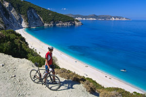 Cyclists in front of Myrtos Beach in Kefalonia