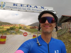 Cyclist is happy that he cycled the whole road up to mt. Olympus