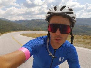 Cyclist is breathing hard during his effort to cycle uphill to the Olympus summit