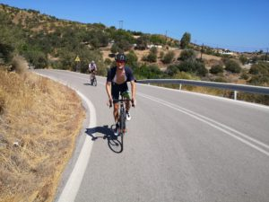 Two road cyclists descend in Greece's empty roads