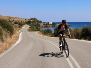 Road cycling on a winding, costal road