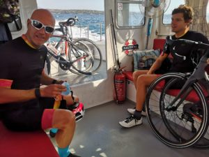 Cyclists with their road bikes use the sea taxi to go from Costa to Spetses
