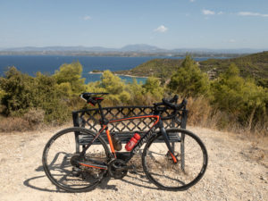 Road race bike in front of the bench with great Spetses sea view