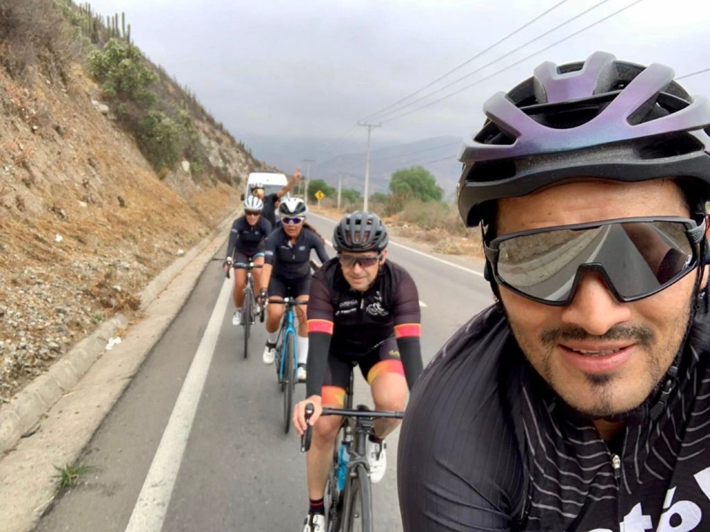 Group of road cyclists during their cycling from Los Antes to Portillo