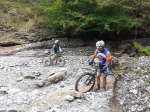 MTBikers cover a steep part on foot during their trip in Olympus