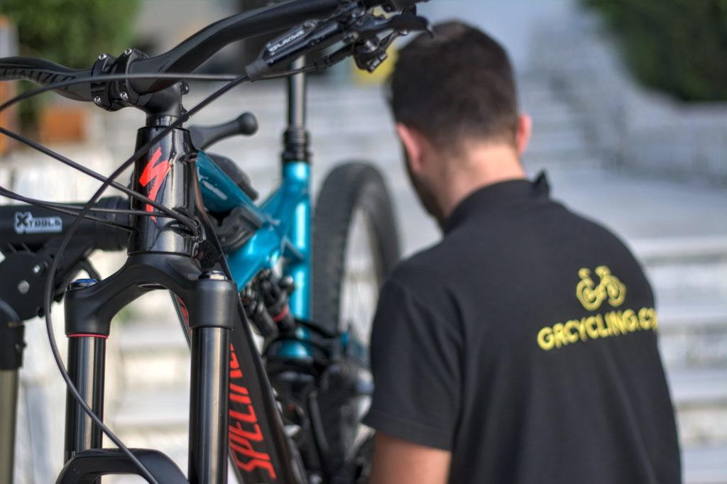 Bike mechanic is repairing a mountain bike