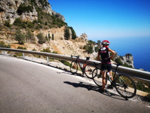 Woman cyclists is looking at the stunning view while she was cycling in the Peloponnese