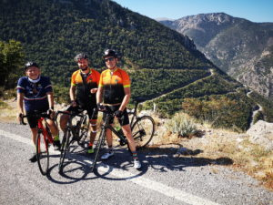 Road cyclists at the top of a climb on Peloponnese mountains