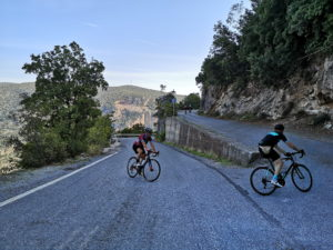 Road cyclists are cycling up of Peloponnese climbs