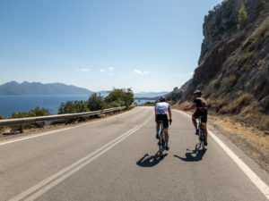 Two road cyclists on the spectacular coastal road