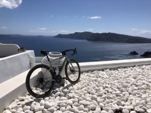 View of a road bike in front of the Santorini's caldera