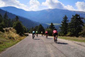 Cyclists are cyclinng through Porto Heli landscape